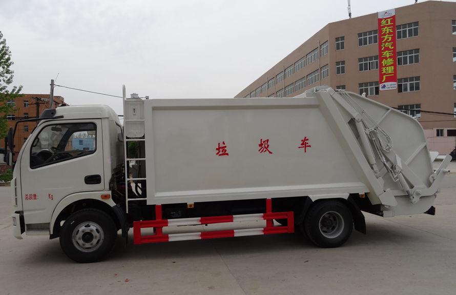 东风8方压缩式垃圾车左侧图片
