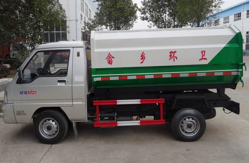 福田3方挂桶式垃圾车图片(车头向左正侧)