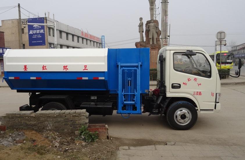东风5方挂桶式垃圾车图片(车头向右正侧)