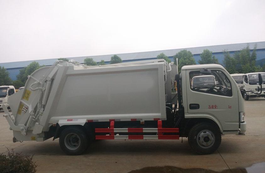 东风6方压缩式垃圾车图片(车头向右正侧)