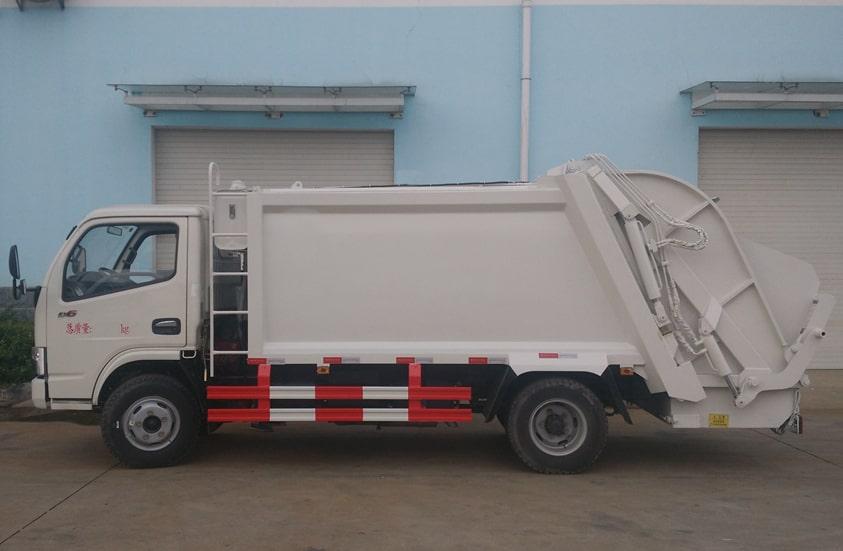 东风6方压缩式垃圾车图片(车头向左正侧)