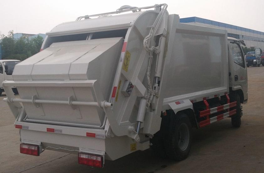 东风6方压缩式垃圾车图片(车头向右后45度)